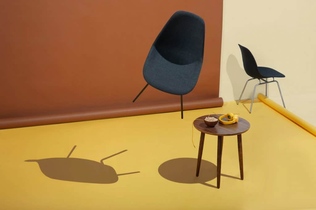 Modern image of chairs and table in retro neutral room